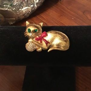 Adorable Napier cat with ball brooch